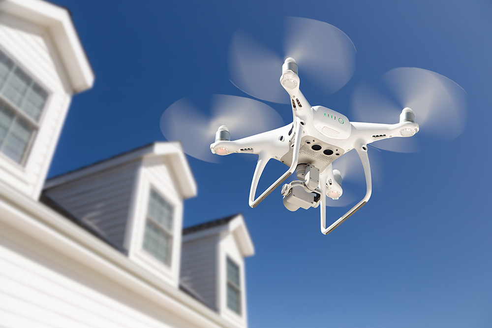 Aerial drone flying while home inspection services are being preformed
