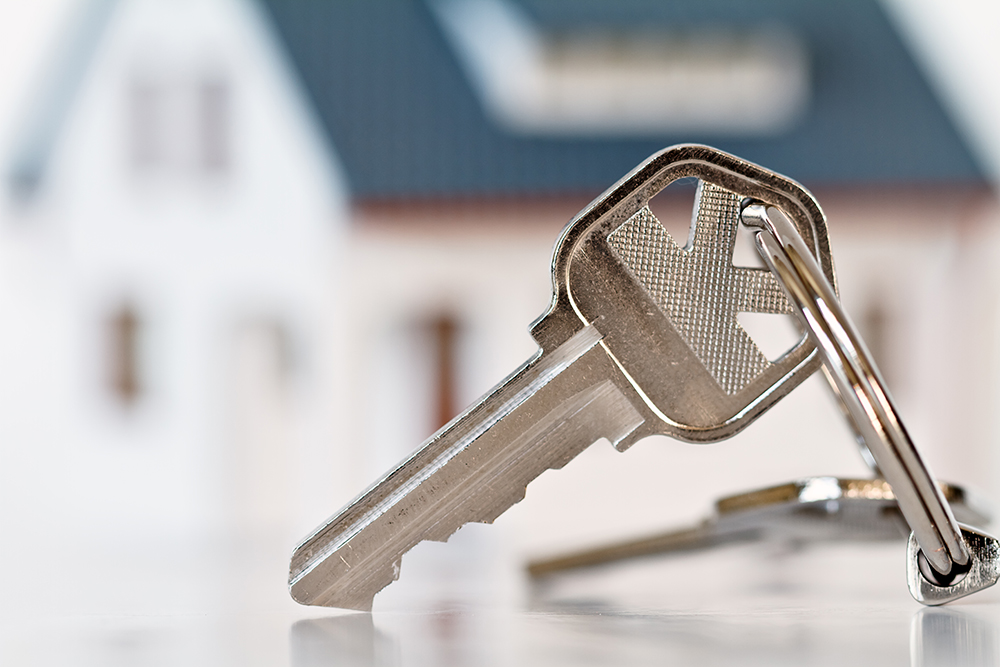 Buyer's new house keys after passing a thorough home inspection services